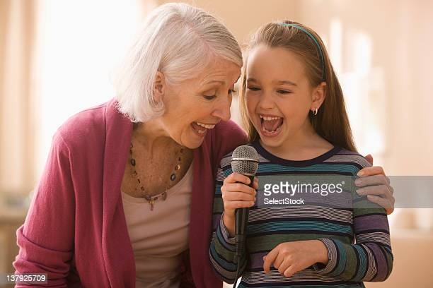 Grandmother and granddaughter with microphone