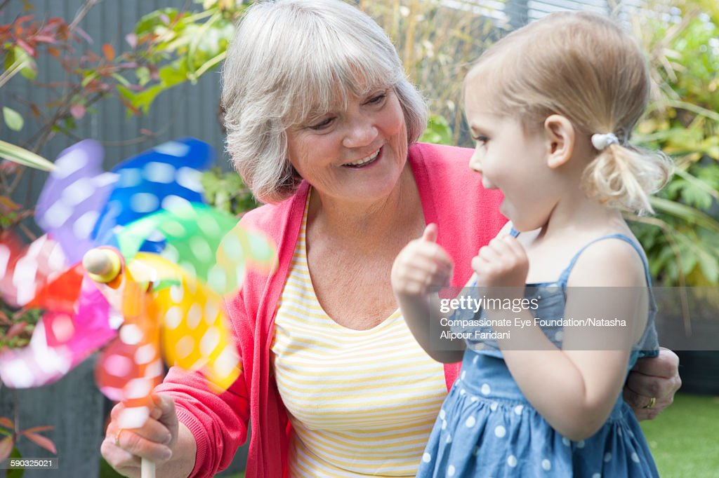 Grandmother and granddaughter with pinwheel : Stock Photo