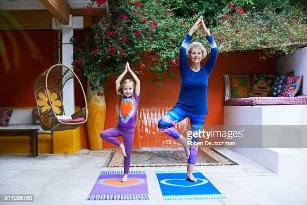 grandmother and granddaughter yoga and meditation
