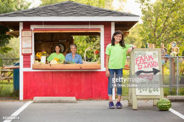 Grandmother and granddaughters at organic farm stand
