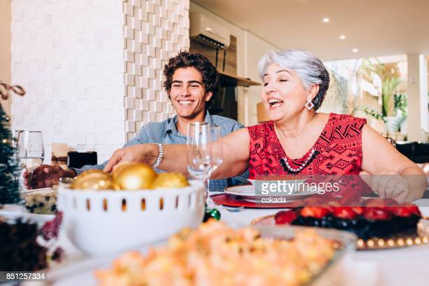 Grandmother and grandson at family lunch