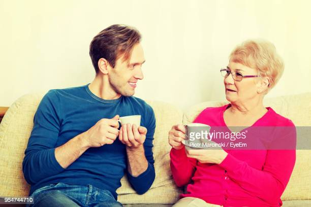 Grandmother And Grandson Having Coffee At Home