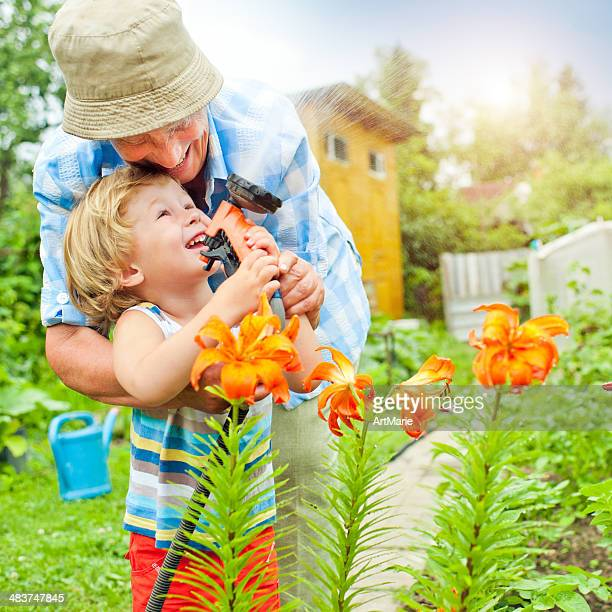 Grandmother and grandson in the garden