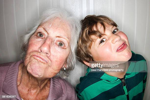grandmother and grandson making funny faces - mamie photos et images de collection
