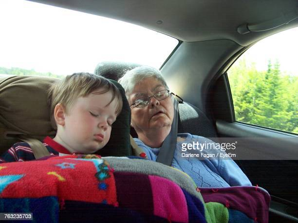 Grandmother And Grandson Napping In Car
