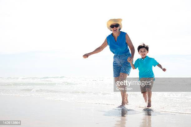 Grandmother and Grandson Running on the Beach