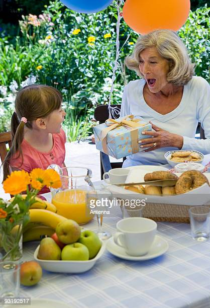 A grandmother and her granddaughter celebrating a birthday