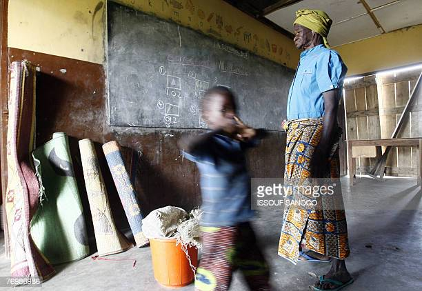 A grandmother and her grandson found a shelter in the primary school in the village of Sandema Northern Ghana 24 September 2007 after they were left...