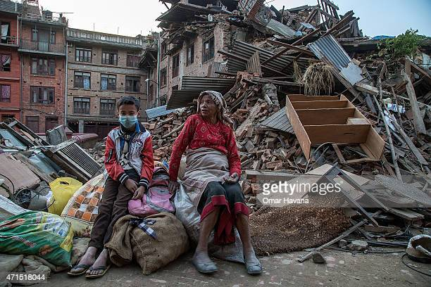 Grandmother and her grandson sit on the belongings that they have salvaged from their collapsed homes on April 29, 2015 in Bhaktapur, Nepal. A major...