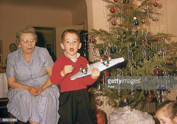 grandmother and one boy at christmas - christmas past and christmas present stock pictures, royalty-free photos & images