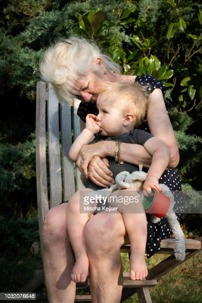 Grandmother and toddler in garden
