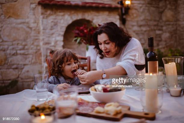 grandmother and young grandson at traditional cottage dinner table - cultura mediterrânica imagens e fotografias de stock