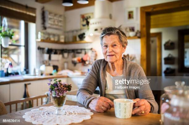 Grandmother at home drinking tea.