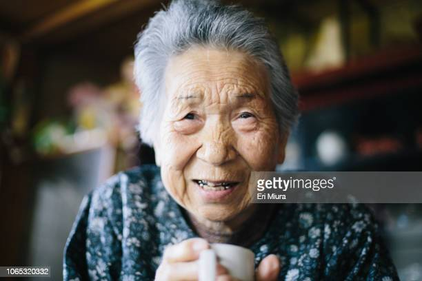 grandmother at home - east asia stock pictures, royalty-free photos & images