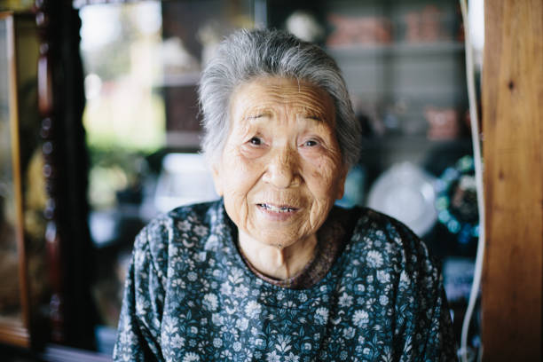 grandmother at home - asian old woman stock pictures, royalty-free photos & images