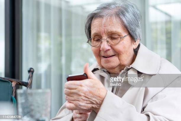 grandmother celebrates her birthday - grandmother stock pictures, royalty-free photos & images