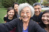 Grandmother, Children, Grandchildren Pose for Selfie, Care Home in Background