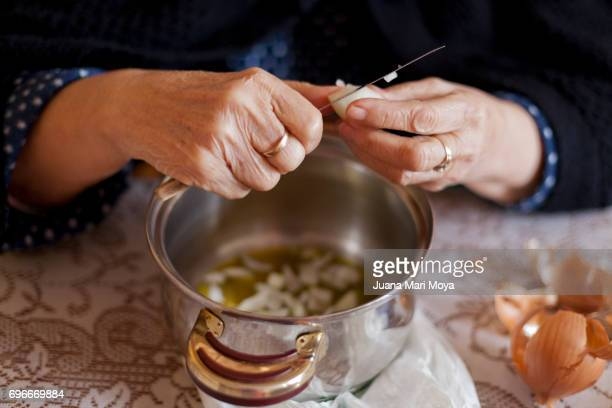 grandmother cooking - grandmother stock pictures, royalty-free photos & images