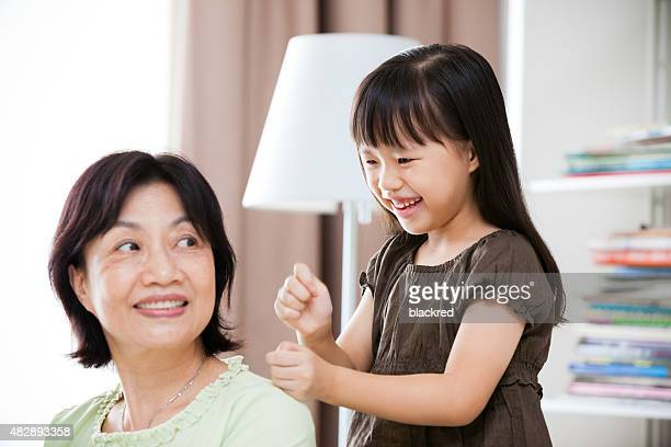Grandmother Enjoying Massage from Granddaughter at Home