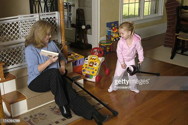 a grandmother enjoys time with her grand daughter. - cerebrum stock pictures, royalty-free photos & images