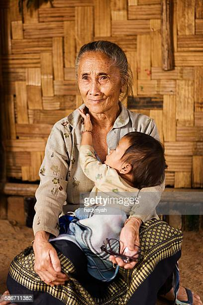 Grandmother from the hill tribe holding her granddaughter