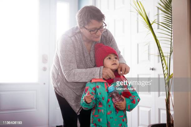grandmother getting dressed her sweet granddaughter - fat granny stock pictures, royalty-free photos & images