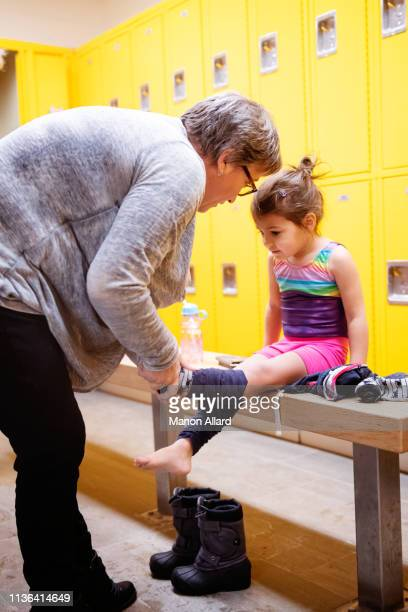 grandmother getting dressed her sweet granddaughter - chubby granny stock pictures, royalty-free photos & images