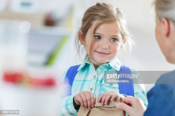 grandmother gives grandmother a sack lunch for school - lunch stock pictures, royalty-free photos & images