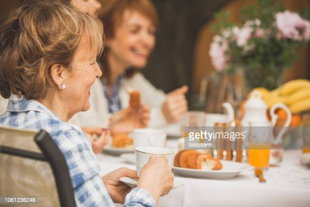 grandmother having brunch with family - the brunch stock pictures, royalty-free photos & images
