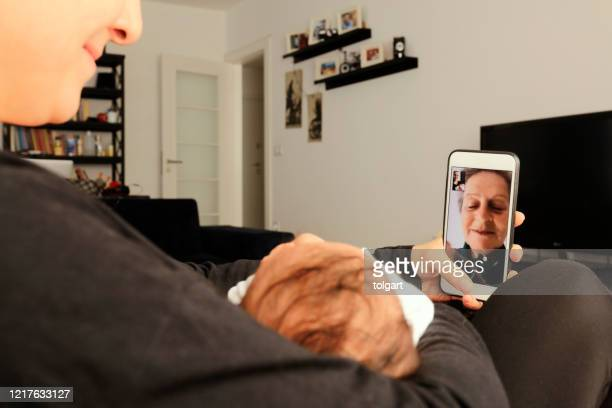 grandmother having video call with granddaughter - turkey middle east stock pictures, royalty-free photos & images