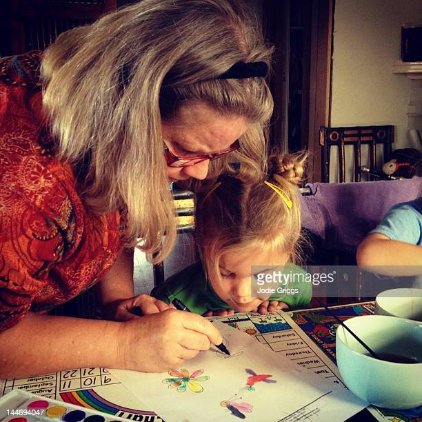 grandmother helping granddaughter - art and craft stock pictures, royalty-free photos & images