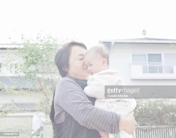 grandmother holding granddaughter - 熊本県 ストックフォトと画像