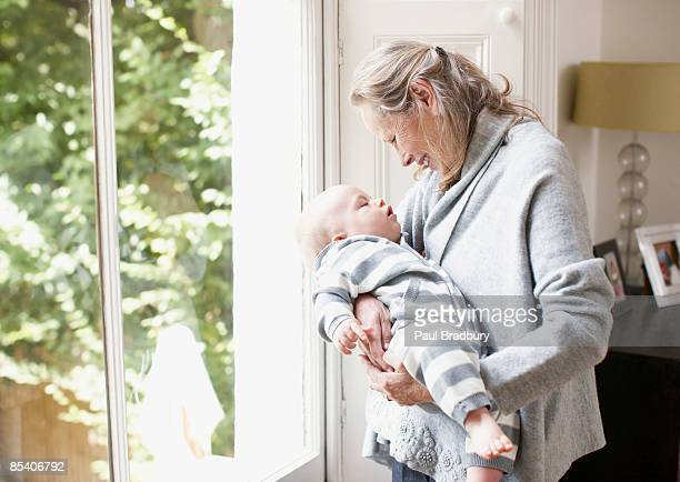 grandmother holding grandson - british granny stock photos and pictures