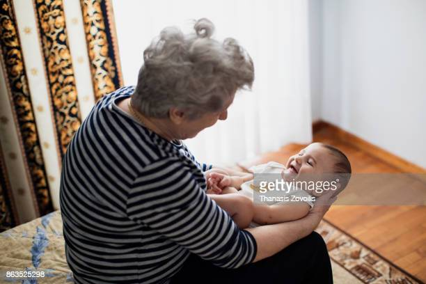 Grandmother holding her grandson