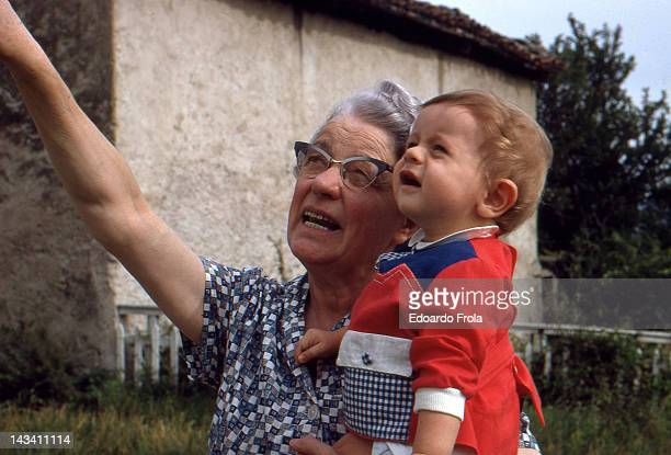 grandmother holding her nephew - 1967 stock pictures, royalty-free photos & images