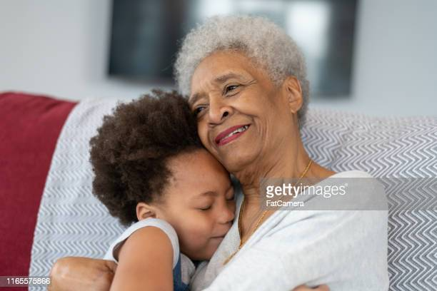 grandmother hugs granddaughter lovingly - fat granny stock pictures, royalty-free photos & images