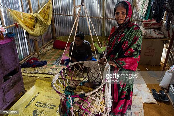 Grandmother is taking care of her grandchildren inside stone workers' village on April 4 2015 in Jaflong Sylhet Bangladesh Stone workers live a...