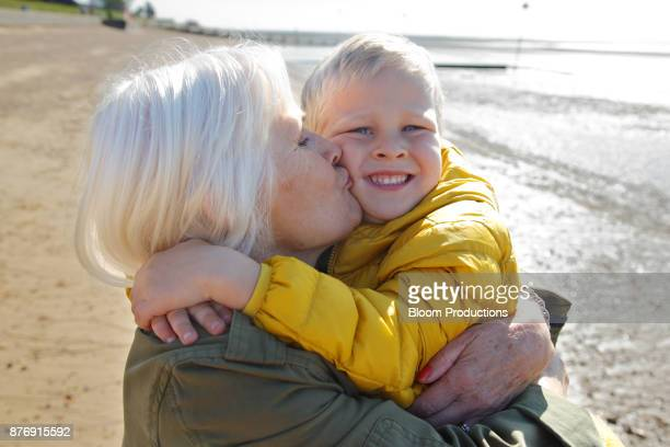 Grandmother kissing grandson on the cheek