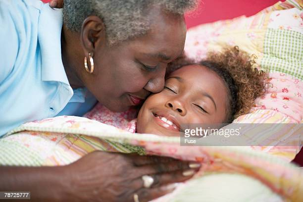 Grandmother Kissing Her Granddaughter Goodnight