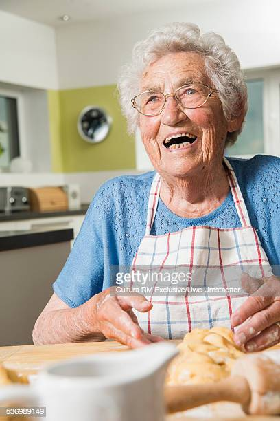 Grandmother kneading dough