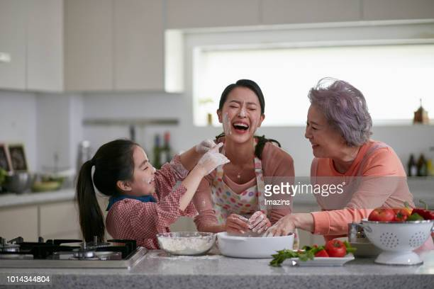 grandmother, mom and granddaughter enjoying cooking - 孫娘 ストックフォトと画像