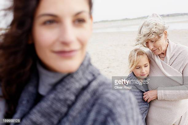 grandmother, mother and daughter on the beach - beautiful granny stock-fotos und bilder