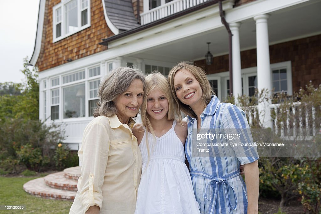 Grandmother, mother and daughter portrait, smiling : Stock Photo