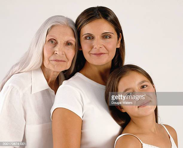 Grandmother, mother and daughter (11-13) smiling, portrait