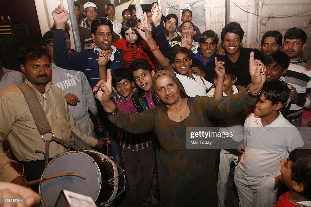 Grandmother of cricketer Parvinder Awana along with other family members celebrate his selection in the Indian cricket test team on 9th December, 2012.