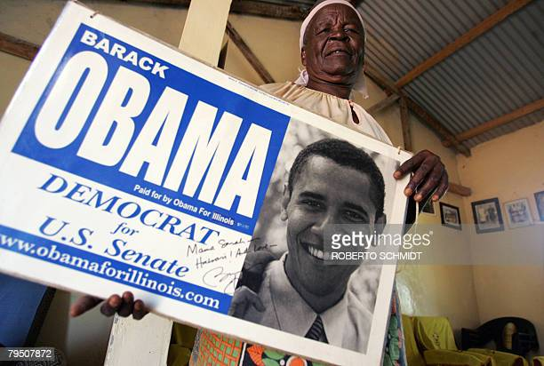 Grandmother of US Presidential candidate and US Senator Barrack Obama Sarah Obama Onyango holds a senate election placard promoting Obama at her home...