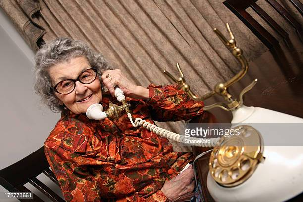 grandmother on the telephone - great grandmother stock pictures, royalty-free photos & images