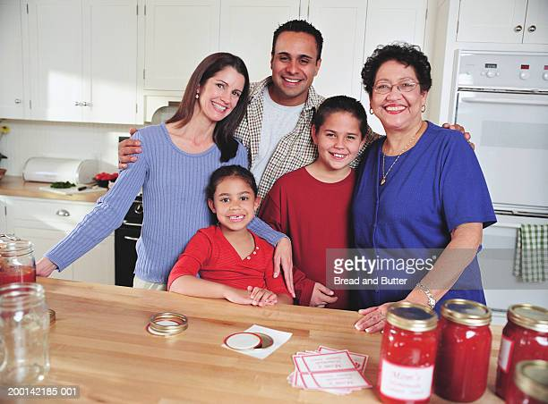 grandmother, parents and children (6-11) in kitchen, portrait - 40 44 jaar stock pictures, royalty-free photos & images