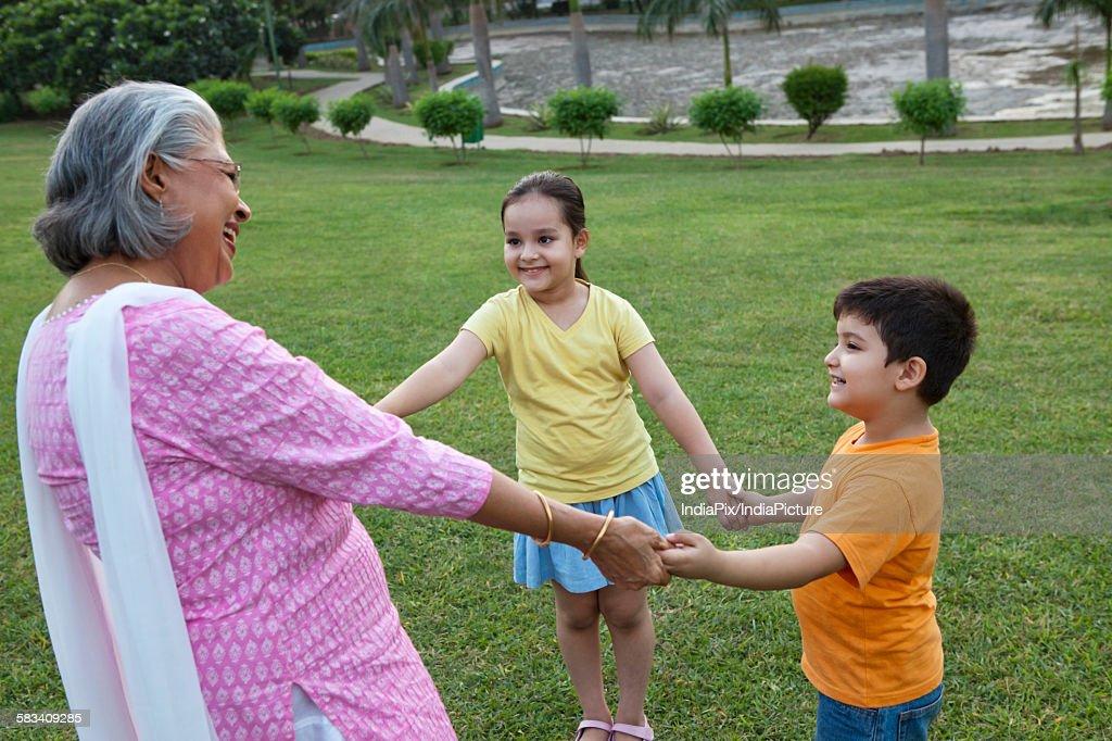 Grandmother playing with grandchildren : Stock Photo