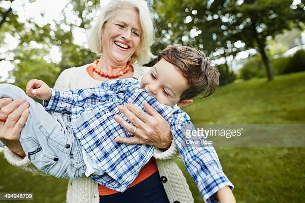 Grandmother playing with grandson outdoors